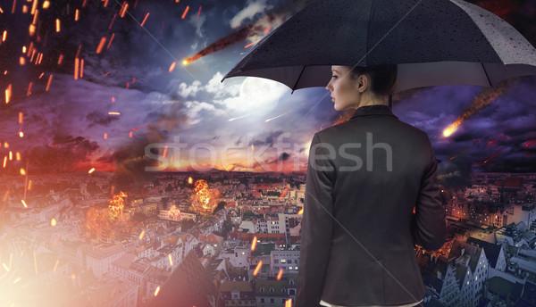 Attractive brunette staring at the natural disaster Stock photo © konradbak