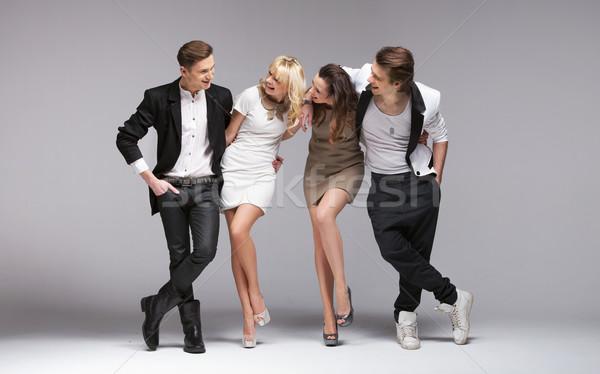 Pequeño grupo riendo modelos jóvenes negocios hombre Foto stock © konradbak