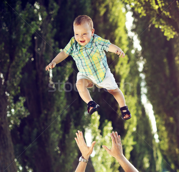 Dad tossing his little kid Stock photo © konradbak
