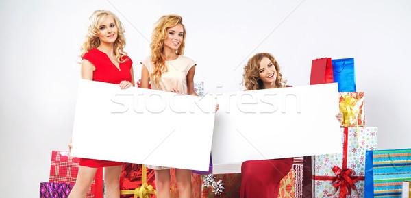 Alluring ladies holding empty billboard Stock photo © konradbak