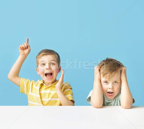 Two expressive boys posing together Stock photo © konradbak