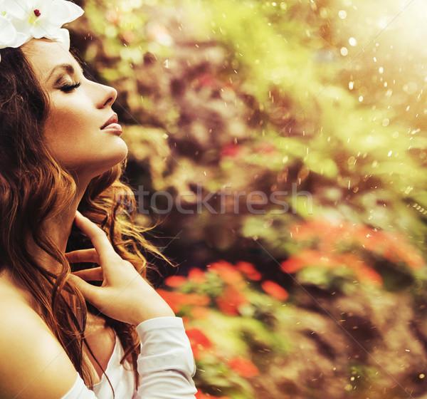Portrait of a cheerful brunette lady wearing a white chaplet Stock photo © konradbak