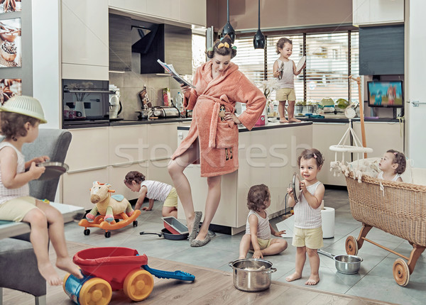 Conceptual image of exhausted mom with her misbehaving child Stock photo © konradbak