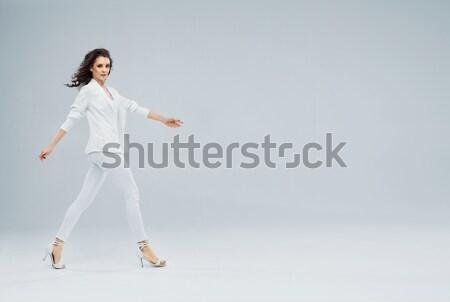 Attractive brunette lady in business uniform Stock photo © konradbak