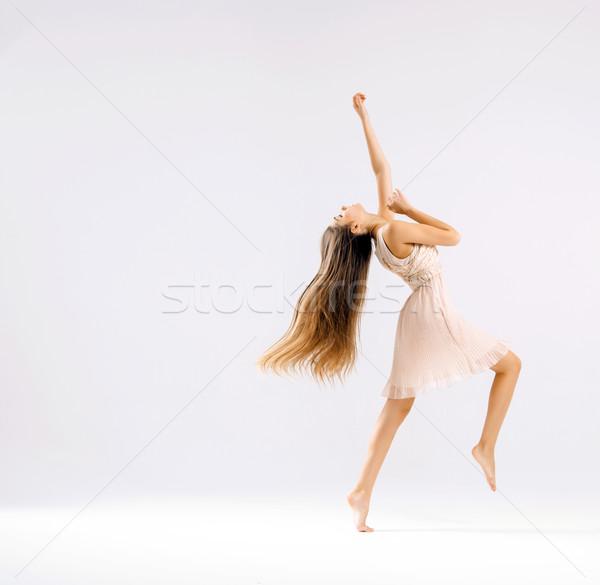 Slim and fit ballet dancer Stock photo © konradbak