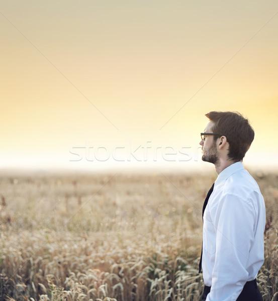 Handsome  businessman staring at the sunset Stock photo © konradbak
