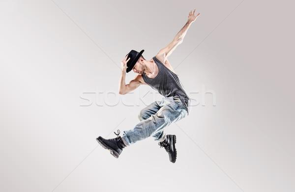 Fashion shot of a young hip hop dancer Stock photo © konradbak