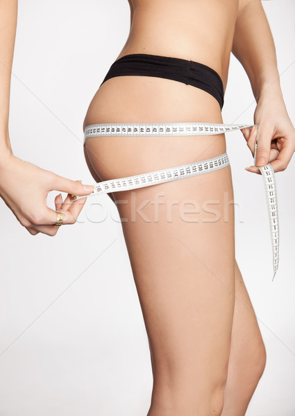 woman measuring perfect shape Stock photo © konradbak
