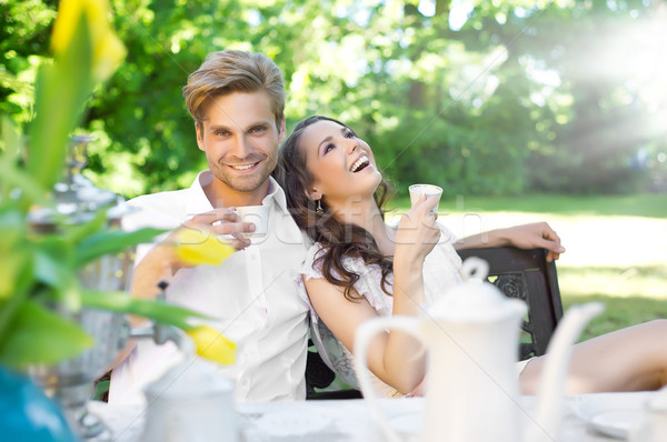 Young couple enjoying lunch in the garden Stock photo © konradbak