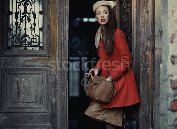 Beauty brunette going out Stock photo © konradbak