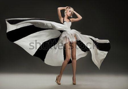 Beautiful woman wearing white dress Stock photo © konradbak