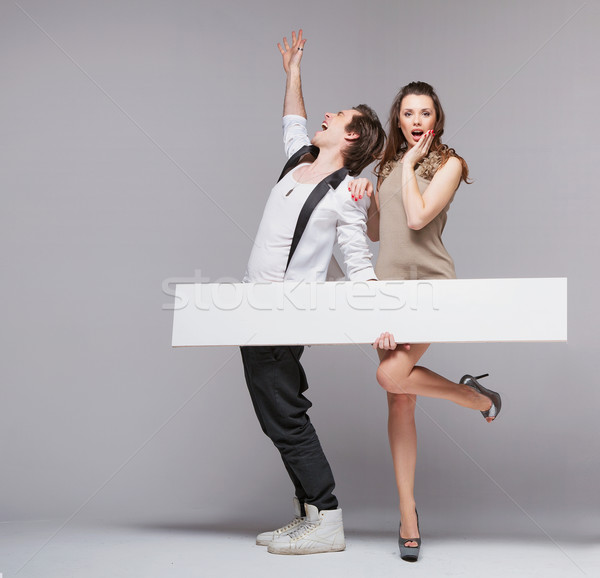 Screaming guy in funny pose with his girlfriend Stock photo © konradbak