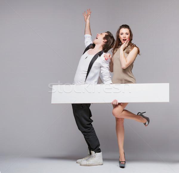 Schreeuwen vent grappig pose vriendin mooie Stockfoto © konradbak