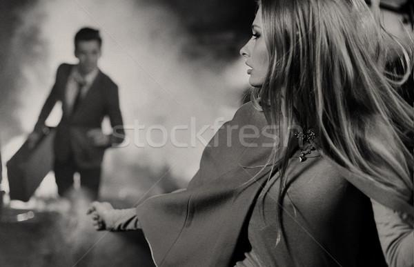 Art picture of man chasing his girlfriend Stock photo © konradbak