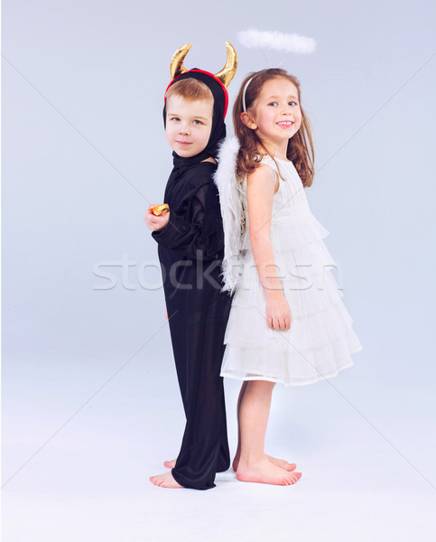 Cute peu enfants diable ange enfants Photo stock © konradbak