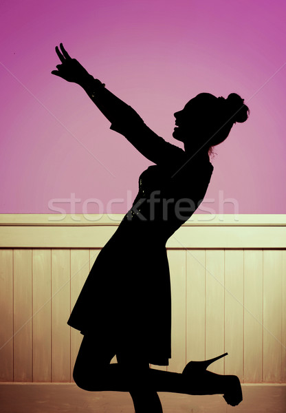 Alluring girl in the dancing pose Stock photo © konradbak
