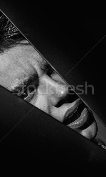 Handsome man being behind the hole Stock photo © konradbak