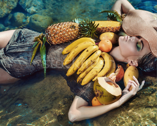 Stock photo: Conceptual portrait of a lady with tropical fruit