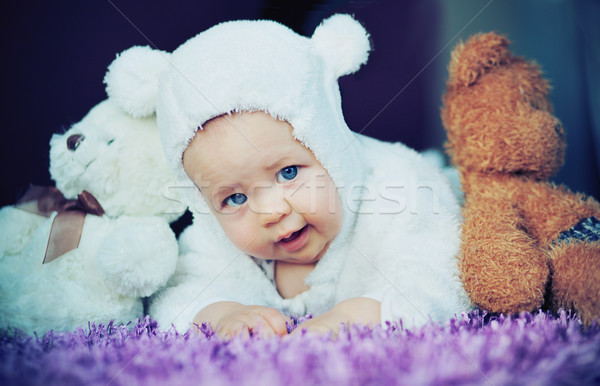 Cute baby with bears Stock photo © konradbak