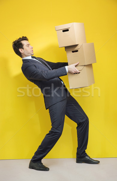 Handsome manager carrying the paper boxes Stock photo © konradbak