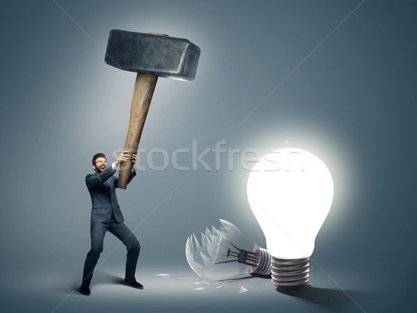 Conceptual image of a businessman holding big hammer Stock photo © konradbak