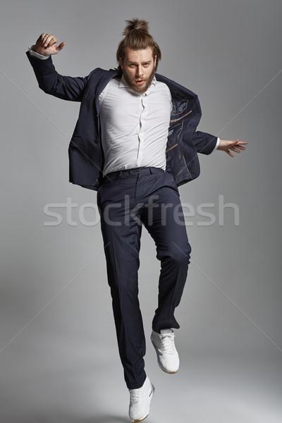 élégant Guy acrobatique bel homme homme heureux Photo stock © konradbak