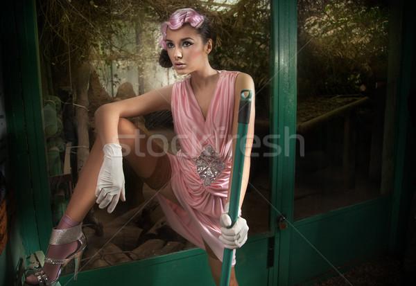 Fiatal csinos divatos takarító rózsaszín ruha Stock fotó © konradbak