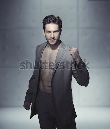 Handsome man casually leaning against the wall Stock photo © konradbak