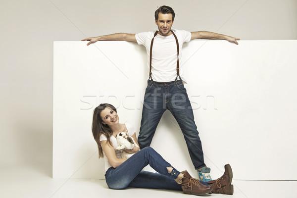 Picture of young attractive couple with rabbit Stock photo © konradbak