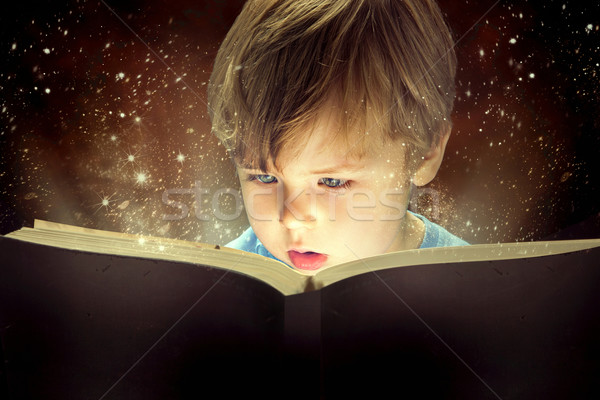 Little boy and the magic book Stock photo © konradbak