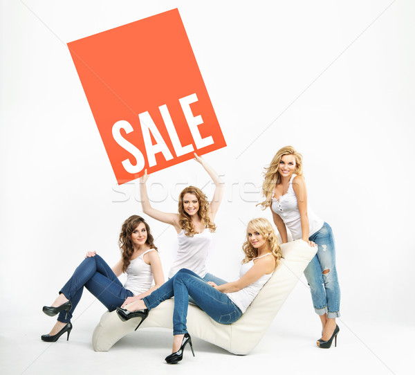 Attractive women promoting middle-season sale Stock photo © konradbak