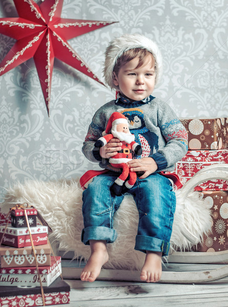 Derűs gyerek ül karácsony szánkó szánkó Stock fotó © konradbak