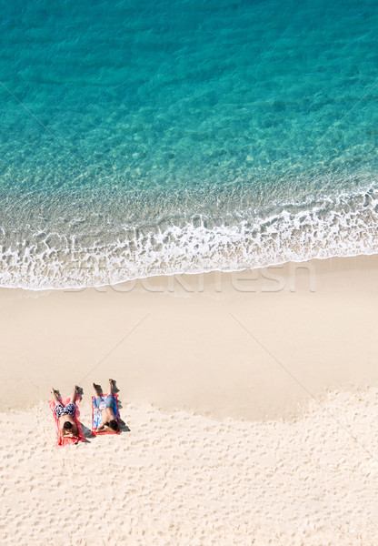 View of two people lying on tropical beach, lots of copyspace Stock photo © konradbak