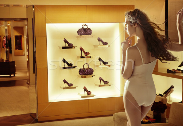 Fashion woman looking at high-heel shoes Stock photo © konradbak