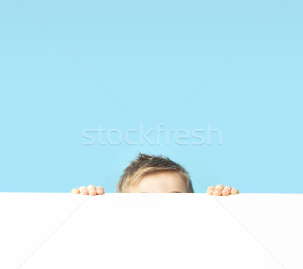 Cute small boy hiding himself  Stock photo © konradbak