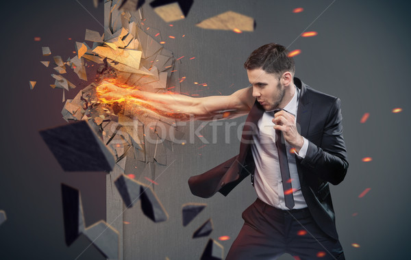 Conceptual portrait of a businessman beating a barrier Stock photo © konradbak
