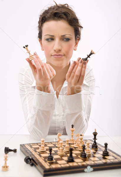 Young businesswoman playing chess  Stock photo © konradbak