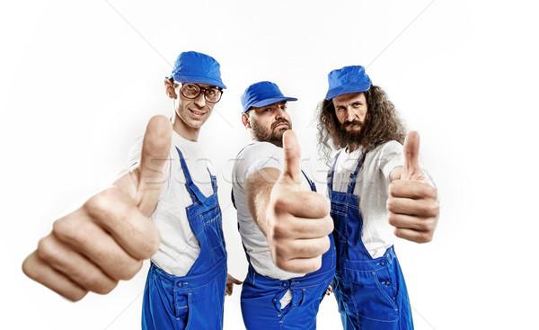 Három bátor készít ahogy kézmozdulat jóképű Stock fotó © konradbak