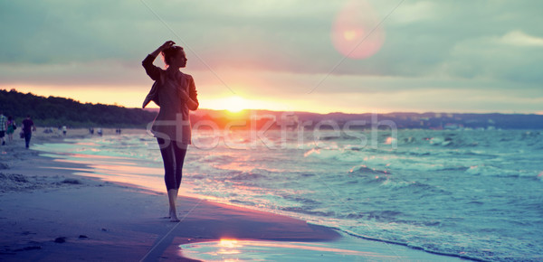 Alluring woman walking along the seaside Stock photo © konradbak