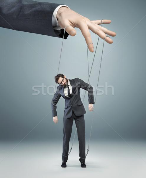 conceptual picture of a boss pulling the strings Stock photo © konradbak