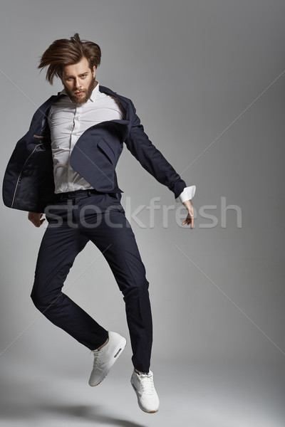 Portrait of the jumping flexible guy  Stock photo © konradbak