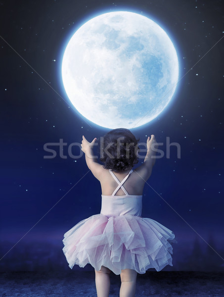 Little baby girl reaching to the moon Stock photo © konradbak