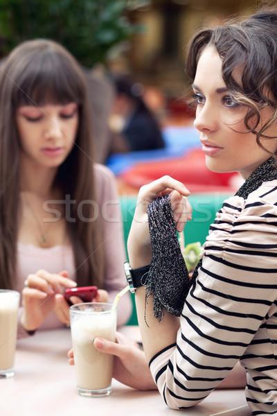 Two young women having lunch break together Stock photo © konradbak