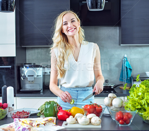 Cheerful blonde making a helathy lunch Stock photo © konradbak