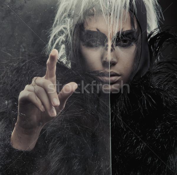 Titokzatos nő mutat valami lány divat Stock fotó © konradbak