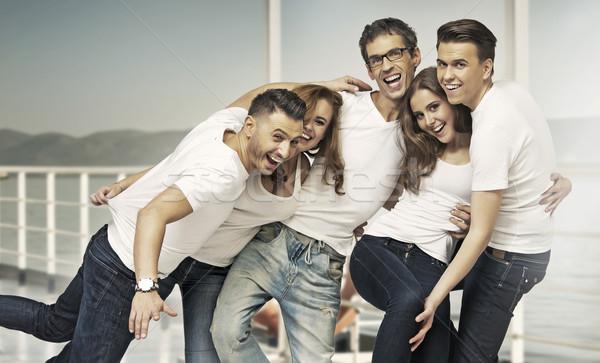 Great shot of attractive group of friends Stock photo © konradbak