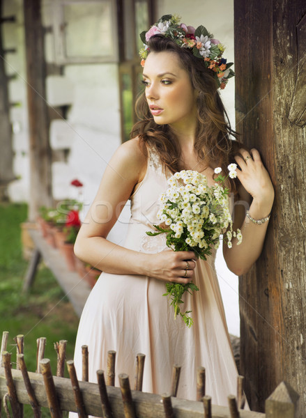 Cute country girl with buquet Stock photo © konradbak