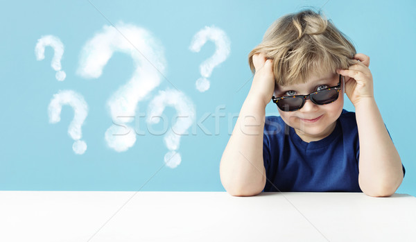 Cute little boy with queries Stock photo © konradbak