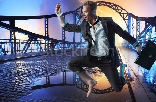 Successful businessman jumping on the bridge Stock photo © konradbak