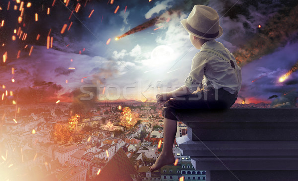 Little boy watching the end of the world Stock photo © konradbak